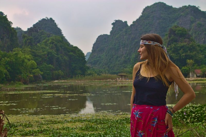 Tina standing by lake, Tam Coc, Ninh Binh, Vietnam