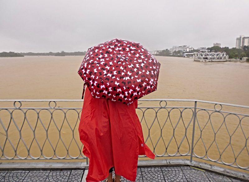 Wearing a rain poncho during rainy season in Asia