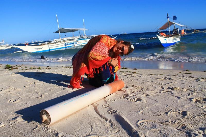 A giant cigarette on Alona Beach, Bohol
