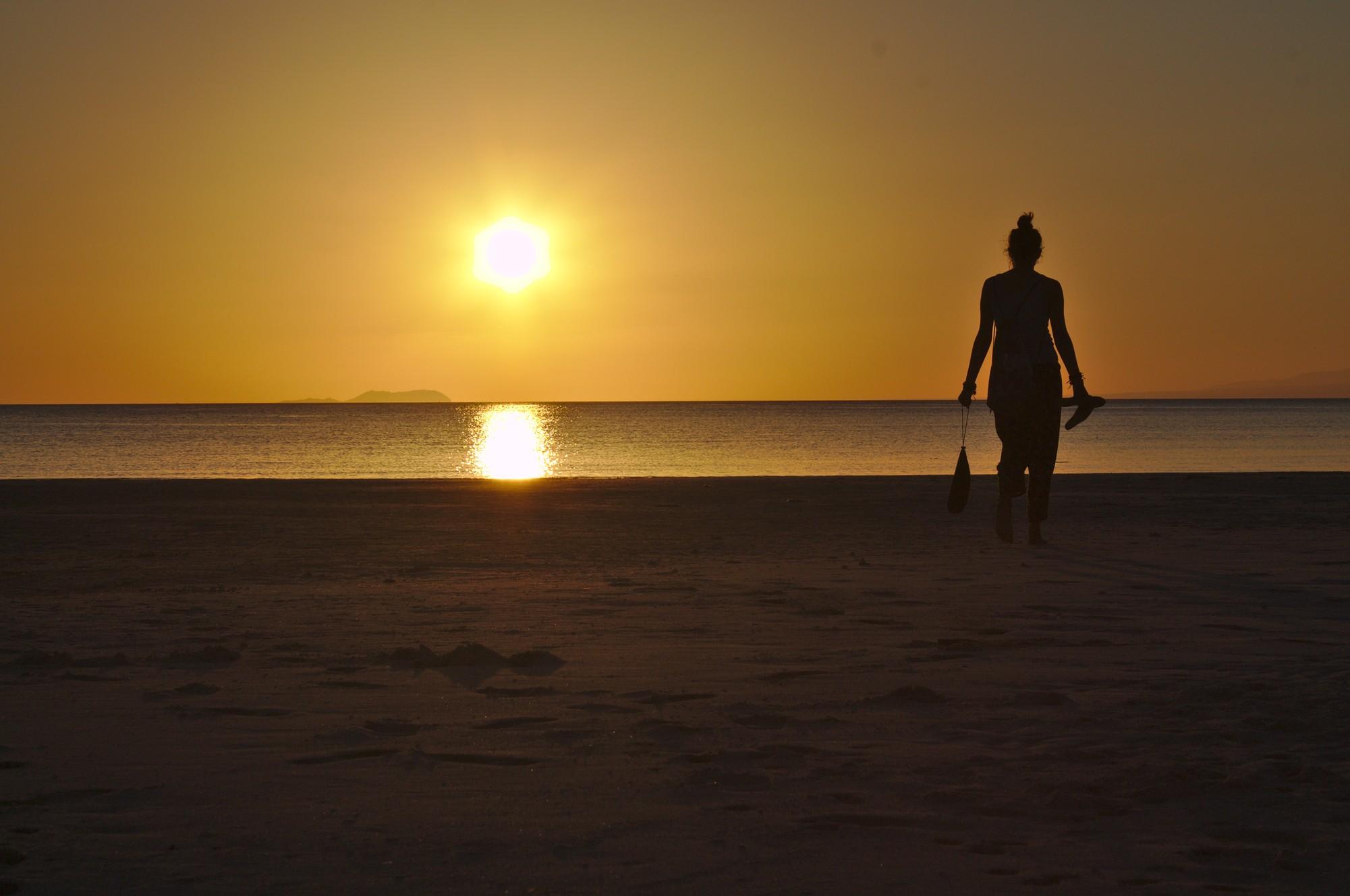 Tina at the beach during sunset