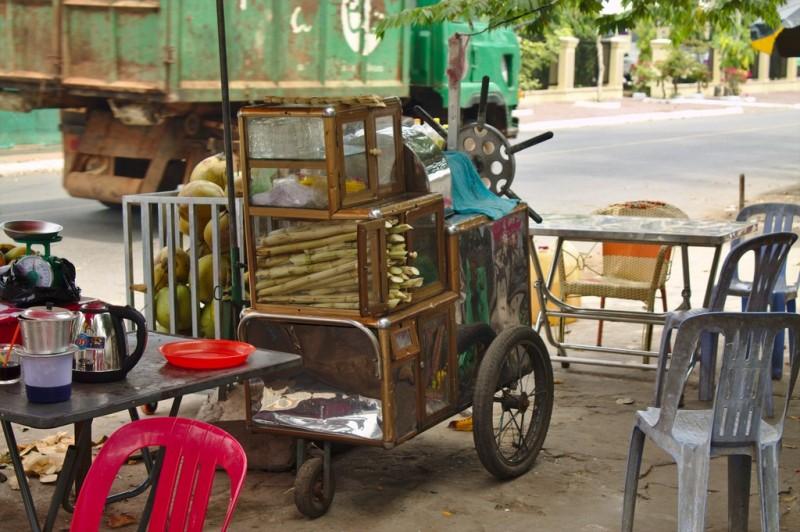 Kampot street vendor with sugar cane juicer