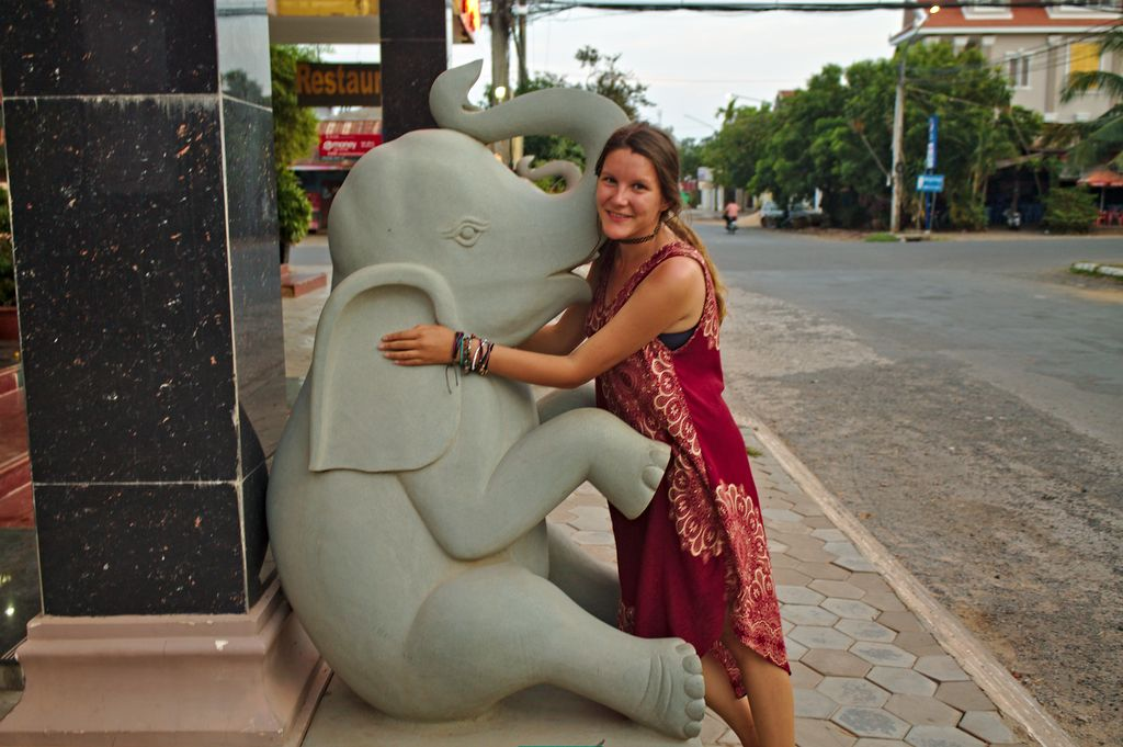 Hugging an elephant baby in the streets of Phnom Penh, Cambodia