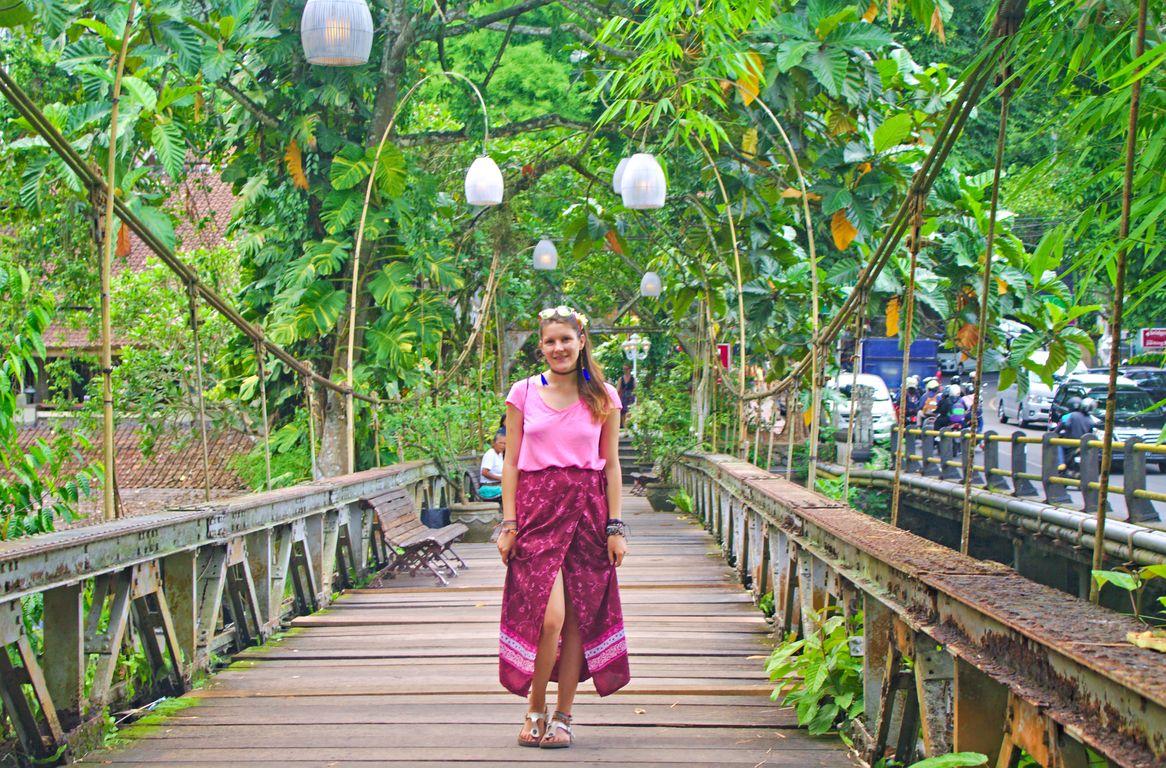 Walking on the wooden hanging bridge in Ubud, Bali