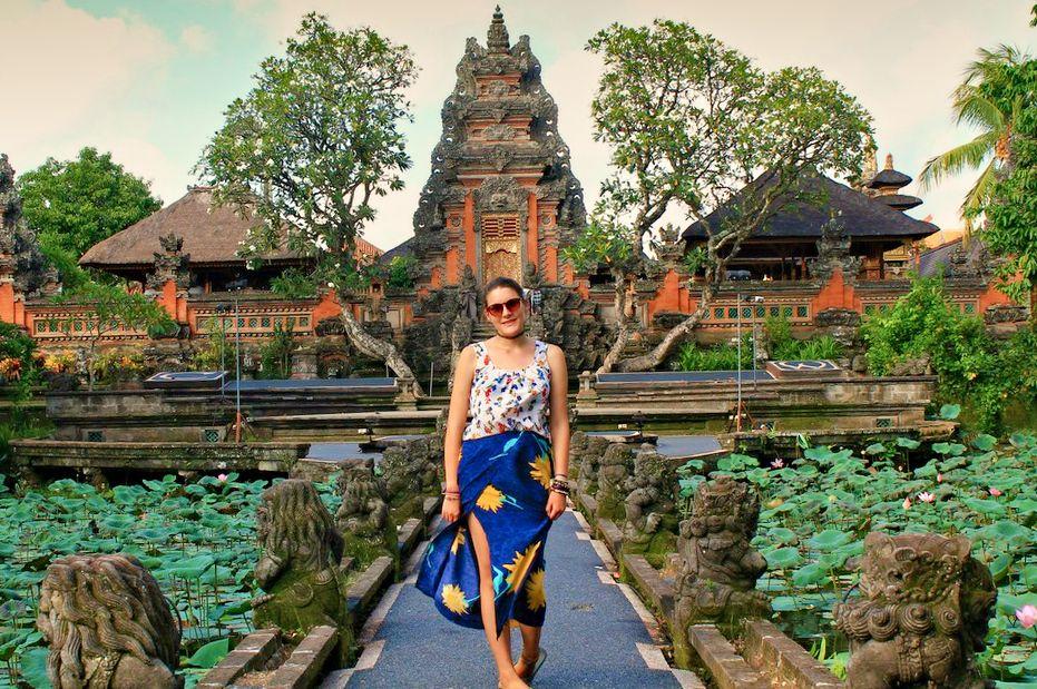 Walking along the Lotus ponds of Saraswati Temple in Ubud, Bali