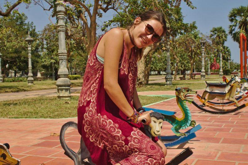 Enjoying a ride on the children playground in Battambang, Cambodia