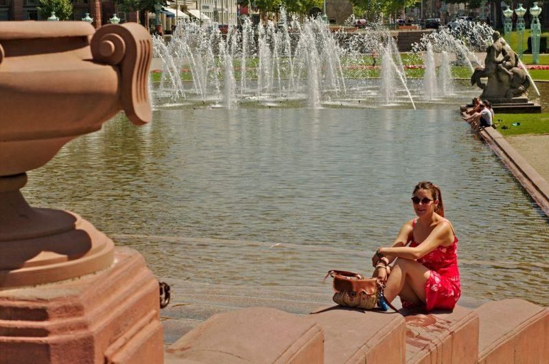Sitting by the fountains around the Wasserturm in Mannheim