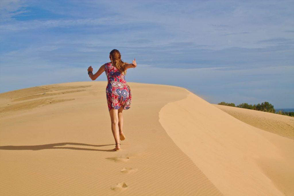 Running up the White Sand Dunes in Mui Ne, Vietnam