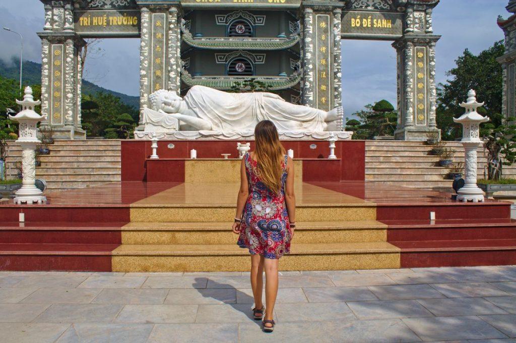 Tina at sleeping lady Buddha statue, Linh Ung Pagoda, Da Nang, Vietnam