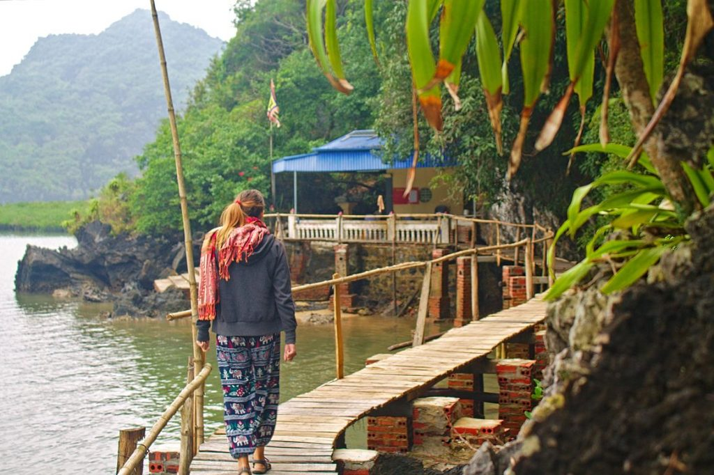 Tina walking on stilted bridge, Cát Bà, Vietnam