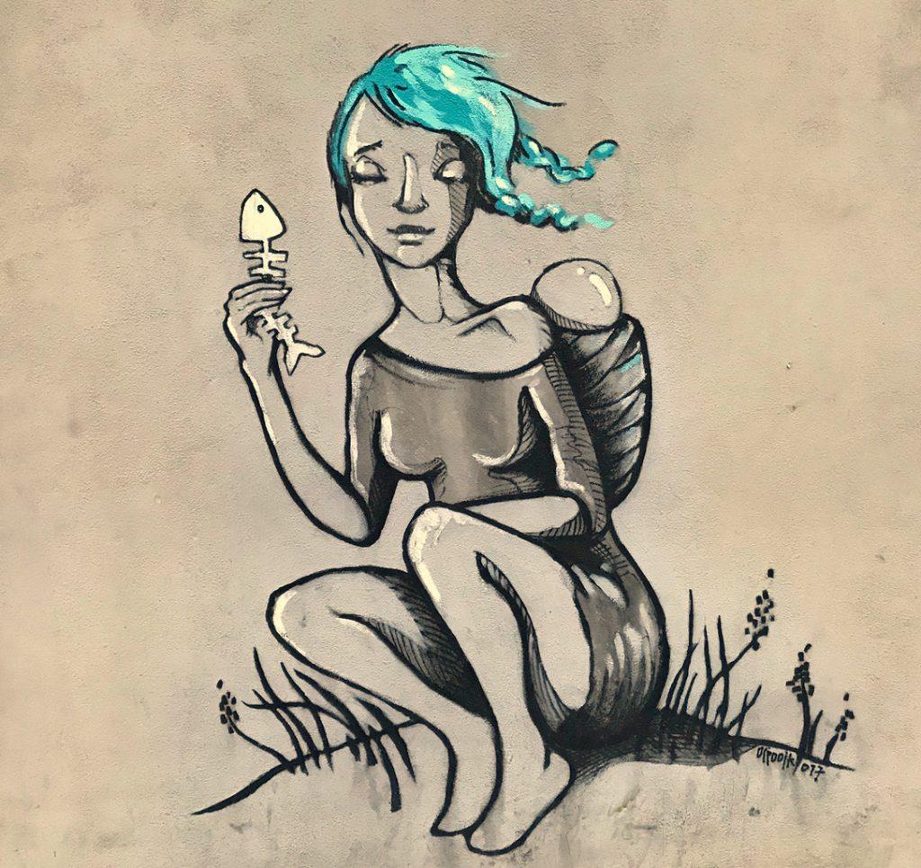 Girl with fishbone, street art, Žižkov, Prague
