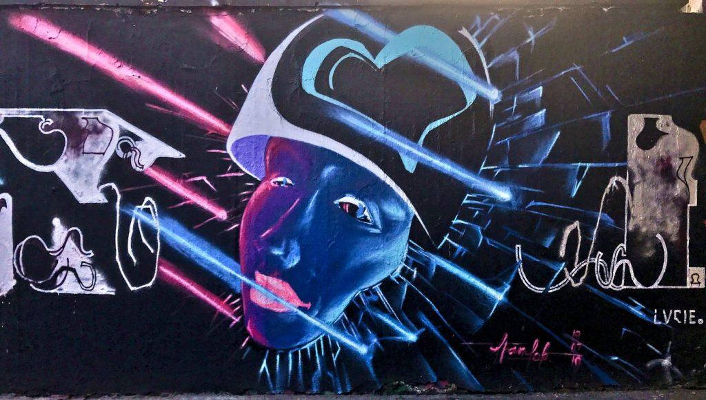 Girl with helmet, street art, Těšnov, Prague
