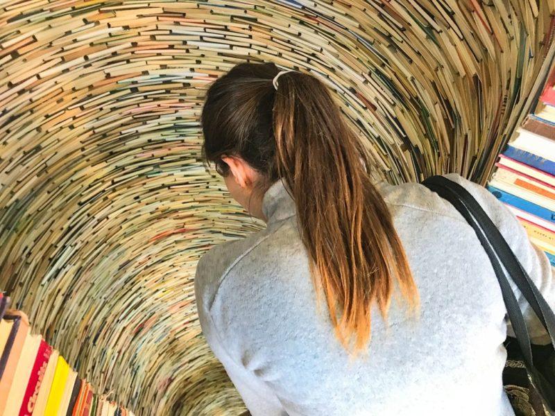 Tina looking inside the book hole, Prague Municipal Library