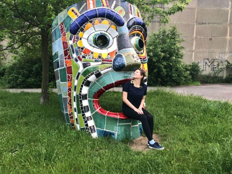 Tina sitting on Mosaic head, Mosaic head, Stodůlky, Central park, Prague
