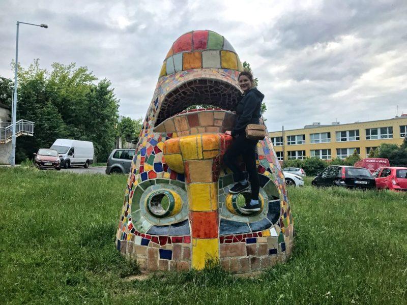 Tina sitting on upside down Mosaic head, Mosaic head, Stodůlky, Central park, Prague