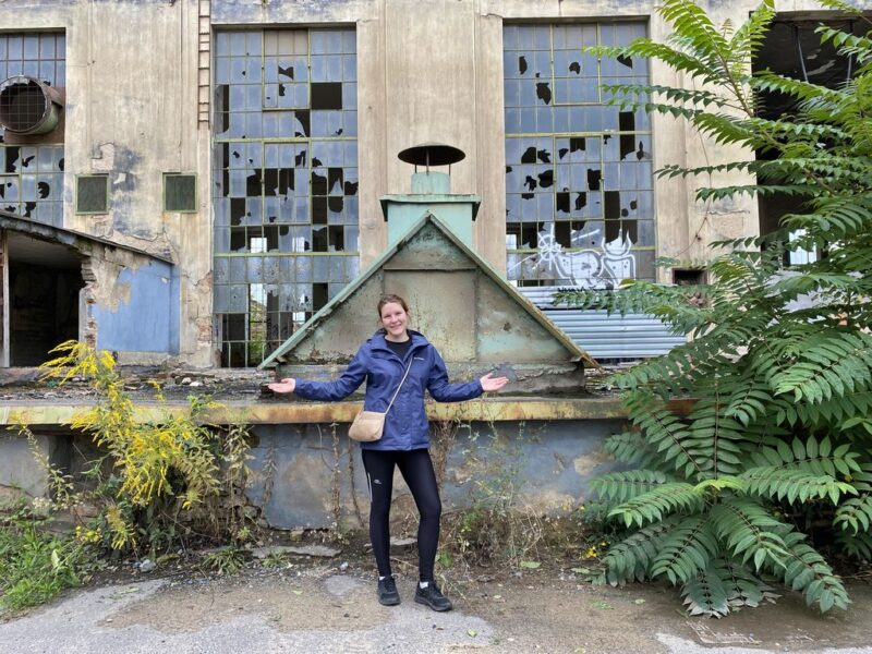 Tina at the abandoned Kolbenova plant, windows, Vysočany, Prague