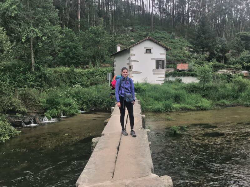 Andrea standing on wood walk, Camino Portugues